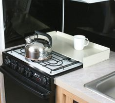 Camco 43557 RV White Universal Fit Stove Top Cover, http://www.amazon.ca/dp/B000EDOSUG/ref=cm_sw_r_pi_awdl_n6j1wb08SEES1