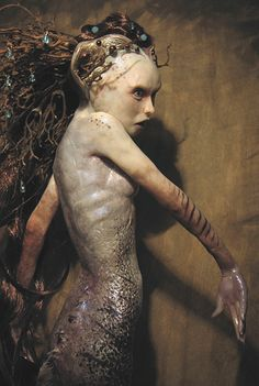 Virginie Ropars--sculpted doll figure, capricious,maybe dangerous nature spirit....