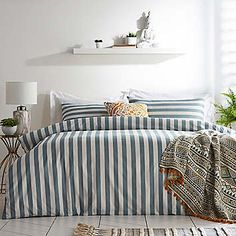 The Alena Stripe bedding is an understated classic. The bed set is produced using the finest 180 thread count cotton percale , making it soft and breathable. The face boasts a subtle steel grey and white stripe with a crisp white reverse. An effortless way to freshen up your bedroom, made with a design and quality which will last for seasons. Due to the nature of 100% cotton product will need ironing after washing as creasing may occur. The Duvet Set includes one standard pillowcase in the…
