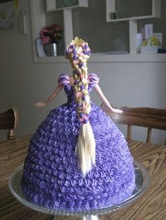 My daughter Caroline is pretty infatuated with Tangled lately and wanted a Rapunzel cake. I got this idea from my sisters friend, thanks...