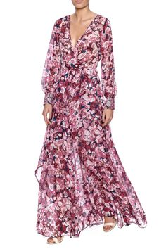 Purple floral printed maxi dress with long sleeves, v-neckline, adjustable waist tie and a hidden zipper closure.  Purple Floral Maxi Dress by Xtaren. Clothing - Dresses - Floral Clothing - Dresses - Maxi Clothing - Dresses - Long Sleeve Los Angeles, California