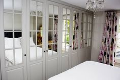 Image result for Silver Frame Mirror 4 Panel Sliding Wardrobe Doors & Storage