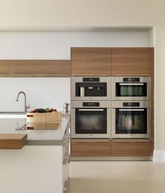 contemporary white and wood kitchen block of Miele appliances Modern Kitchen Ovens, European Kitchen Cabinets, European Kitchens, Kitchen Images, New Kitchen, Cool Kitchens, Ovens In Kitchens, Kitchen Wood, Kitchen Appliance Storage