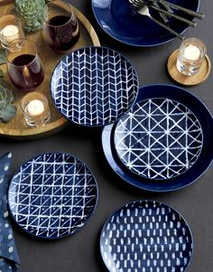 Made with a resist method similar to the technique used to make technique batik textiles, these plates begin as white stoneware. A resist-material is applied to the plate, which is then glazed deep indigo blue. After glazing the resist material is removed, resulting in an artisan-like, blue-and-white pattern.