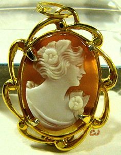 "Elegant hand carved shell vintage cameo pendant jewelry. Featuring a beautiful lady's profile. Oval shell cameo 18x13mm in size. Gold setting approx. 1-1/8"" x 3/4"" widest. Lady cameo is set in a 12k Yellow Gold Filled prong setting with a round bale. Hallmarked on back side of setting. Estate cameo. Excellent Condition. www.etsy.com/shop/SylCameoJewelsStore"