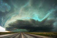 * Green, oh so green * This is my take on the beautifully colored and shaped HP supercell rolling over the town of Stratford in the Texas Panhandle while the tornado sirens are howling. We chased this tornadic storm from the very beginning for hours until we had to stop and let it roll over us without getting hit by large hail nearby... And by the way if you have not already noticed - that green on this storm was truly incredible Stratford, Texas, USA May 16th, 2016