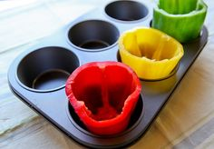 use a large muffin pan to cook stuffed peppers in the oven- it will keep them upright.
