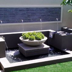 Wok Bowl on entertaining area, on top of a block. but will with water and lillies