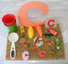 A simple sensory bin created to introduce toddler to the letter 'C'. Letter C Preschool, Letter C Crafts, Letter C Activities, Alphabet Crafts, Preschool Activities, Alphabet Board, Preschool Projects, Preschool Books, Alphabet Letters