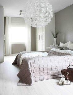 grey walls and giant dandelion -like chandelier.
