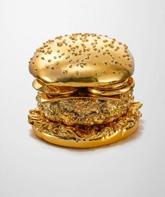 Golden Hamburger | BRANSCH artist Thomas Hannich photographed a golden hamburger created by model-maker Arndt von Hoff especially for this photo shoot.