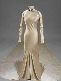 Miss Baba Beaton wore this dress when she married Mr Alec Hambro on 6 November 1934. It is an early example of the work of the designer Char...