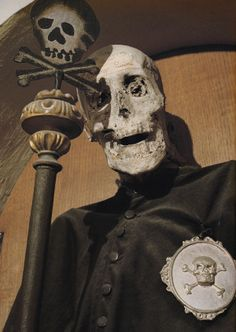Vincenzo Piccini is the only clothed mummy in the Chiesa Dei Morti of the Confrternity of Buona Morte in Urbania, Italy. He is dressed in the robes of the religious order he was a member of and he wears the silver badge of death.