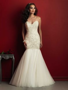 Allure Couture C362 We incorporated light layers of tulle into this striking beaded gown for a delightful complementary texture.