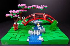 Japanese tea garden Lego scene with cherry tree, moon bridge, and geisha.