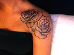 Cartoon roses,  http://tattoomagz.com/roses-tattoos-on-shoulders/black-and-white-rose-tattoo-on-shoulder/