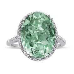 This huge 8ct oval shape green amethyst and diamond ring in sterling silver features an enormous green amethyst accented by diamonds in J-K color and I1-I2 clarity.  The total weight of the green amethyst is 8.10ct and the diamond weight is 0.02ct.