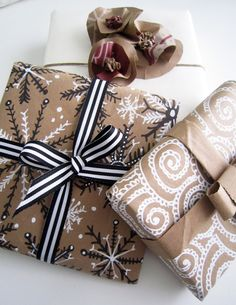 holiday wrapping with brown paper bags, a black sharpie and a white correction pen.