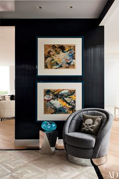 Two Willem de Kooning works on paper hang next to a Bullard-designed chair and a Ligne Roset side table in the dining room.