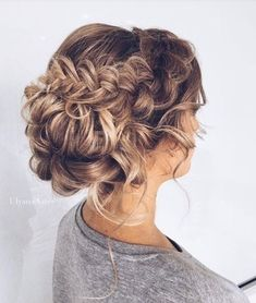 18 Elegant Hairstyles for Prom: #8. Fishtail Low Bun with Curls