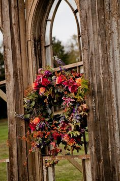 Fall Wreath on Rustic Cathedral Door | photography by http://doveweddingphotography.com/