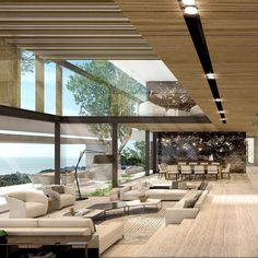 Another image of Enanos set in Barcelona, Spain. A large skylight in the living area lets in maximum light. Design Exterior, Interior And Exterior, Interior Design Living Room, Living Room Designs, Sunken Living Room, Living Area, Spacious Living Room, Modern House Design, Home Fashion