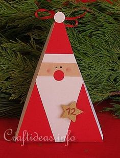 "This is a gift box, but liking the idea of a simple triangular Father Christmas ("",)"