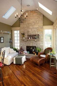 the floors, the fireplace, the vaulted ceiling with sky lights, and the windows.. love this room