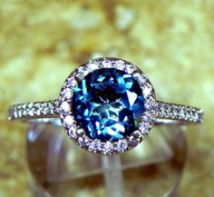 AAAA Natural London Blue Topaz Round Carats in white gold Halo ring with carats of diamonds MMM 4003 Engagement Rings Under 1000, Colored Engagement Rings, Gemstone Engagement Rings, Topaz Color, London Blue Topaz, Halo Rings, Blue Sapphire, At Least, White Gold