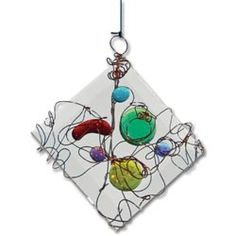 Wire-Wrapped Glass Art ~ United Art and Education...I might use small craft mirrors as a base