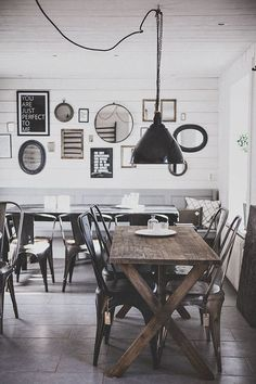 Black and white with wood just looks so classy - consider black chairs and wooden tables