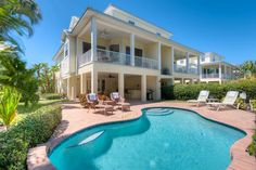 Dolphin House, 311 64th Street, Holmes Beach, Fl. 34217, Nestled right in the midst of Anna Maria Island is this stunning 3 bedroom 2.5 bath townhome with private heated pool. ...