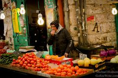 I liked this shot of a Jerusalem food vendor sampling his own products. It was a chilly, chilly day in Israel.