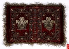 Embroidered chemise binding of crimson velvet with seed pearls and silver thread with Prince Henry's badge and motto.   Italy, Central (Rome and Florence)