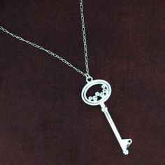 http://purpleleopardboutique.com/1699-4386-thickbox/silver-plated-chain-with-cz-key-pendant-.jpg