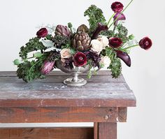 Maria Maxit in Houston uses greens and splashes of burgundy to design an aromatic arrangement that smells, if not tastes, as good as it looks