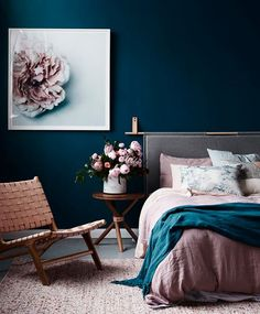 This dreamy bedroom features rose-colored linens that play well with indigo walls and a unique grey headboard with copper detailing. | Photographer: Adore