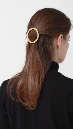 Circle Hair Barrette in Gold. Large, rounded circle barrette. Tied up, pulled back, clipped and secured, Parisian barrette. size / fit - gold metal - 2.4 inches wide