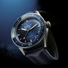 """Blancpain introduced the modern-day version of its Fifty Fathoms Bathyscaphe watch in 2013, the original model's 60th anniversary year. At Baselworld 2017 in March, the collection adds a feminine, 38-mm version outfitted in """"Abyss Blue,"""" a color Blancpain says was inspired by the ocea"""