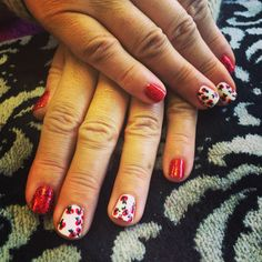 Red poppy nail art design with red glitter in shellac by Evie at Tranquility Spa Hornchurch, Essex x