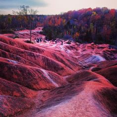 Cheltenham Badlands, Caledon, Ontario - Beautiful place to explore with unique landscape. The badlands formation is almost red in color due to iron oxide deposits. Friends the best time to explore this attraction is during autumn. Best Vacations, Vacation Destinations, Travel Images, Travel Pictures, Cheltenham Badlands, Places Around The World, Around The Worlds, Hiking Places, Hiking Trips