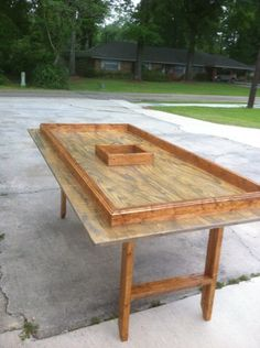 Folding crawfish table with moveable trash can hole
