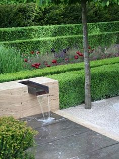 garden design by luciano giubbilei. manicured landscaping and water feature.