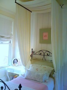 Two upside down curtain rods provide the height while the fabric provides the privacy. Transforms any bedroom with ease.