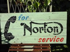 Phone for Norton Service. Handmade and painted wooden sign