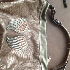 Miss me purse Copper colored miss me purse. Very roomy. Straps look a little worn but in good shape Miss Me Bags Shoulder Bags