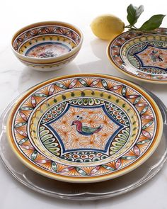"""Aveiro"" Dinnerware  $152.00-$185.00  Crafted by hand in a small Portuguese pottery, this delightful dinnerware design is based on 17th-century motifs. We were particularly charmed by the different animals in the center of each piece.  Handcrafted of ceramic with a meticulously detailed, hand-painted design.  Each piece sold in sets of four.  Dishwasher and microwave safe."