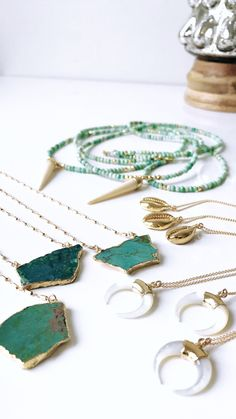 What a better way to welcome a touch of color in your life than with a little turquoise! This gorgeous necklace is made with a stunning real turquoise nugget rimmed in 24k gold, suspended from a high