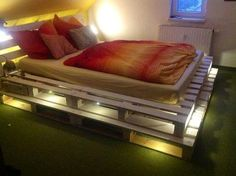A shining wooden pallet bed is shown in the picture which is looking so nice because the lights makes it gorgeous which is not first. And you can also watch in the picture that the wooden planks are painted with white color and the white lights are fixed in this wooden project which gives us a perfect look in the room.