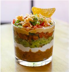 You know how the 7 layer dip looks great until people start going to town on it and then its a sloppy yuck mess? Well... 7 layer chip dip Shots! - individual glasses.